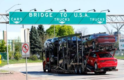 FILE PHOTO - A car hauler heading for Detroit, Michigan, drives on the lane to Ambassador Bridge in Windsor